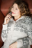 Calls on the couch. Young woman with cell phone relaxing on a couch Stock Photo