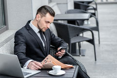 Calls customers. Businessman holding a phone and is going to cal Royalty Free Stock Photography