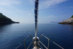Calm Adriatic sea. Front of the sailing boat, calm sea. Adriatic sea Royalty Free Stock Photo