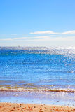 Calm Atlantic ocean seascape. Sandy beach on Tenerife, Canary Islands. Calm Atlantic ocean seascape Stock Photos