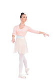 Calm attractive ballerina posing with her arms extended Royalty Free Stock Photo