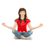 Calm attractive teenage girl in lotus pose Stock Photography