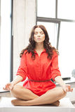 Calm attractive woman in lotus pose Royalty Free Stock Photos