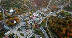 Calm autumn evening view over small city center in East North Europe with a lot of Trees in Fall Colours stock footage