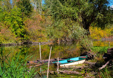 Calm autumn lake for fishing, and boats Stock Photography
