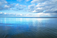 Calm Baltic sea with blue sky Stock Images