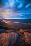 Calm Baltic sea landscape with stones. Winter Baltic sea coast in the evening at Tallinn Stock Image