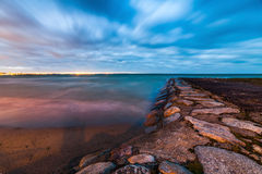 Calm Baltic sea landscape with stones. Winter Baltic sea coast in the evening at Tallinn Stock Images