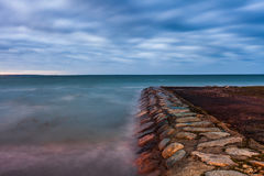 Calm Baltic sea landscape with stones. Winter Baltic sea coast in the evening at Tallinn Royalty Free Stock Photography
