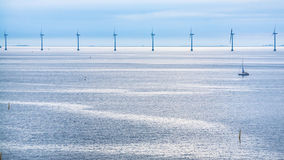 Calm Baltic Sea with offshore wind farm in morning Stock Image