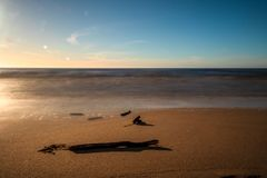 Calm Baltic sea seashore beach background in golden hour. Calm Baltic sea background in golden hour beach sand dune grass latvia sunset path landscape sky coast royalty free stock images