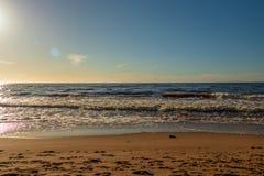 Calm Baltic sea seashore beach background in golden hour. Calm Baltic sea background in golden hour beach sand dune grass latvia sunset path landscape sky coast stock image