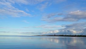 Calm bay of lake and sky pan stock footage