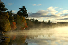Calm bay at sunrise over beautiful lake Royalty Free Stock Photography