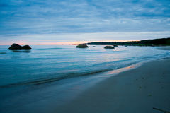 Calm bay on sunset. Calm bay with stones on sunset Royalty Free Stock Images
