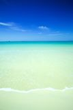 calm beach with crystal blue waters Stock Image