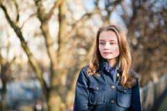 Calm beautiful girl outdoors Stock Image