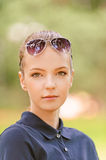 Calm beautiful young woman in sunglasses Stock Photo