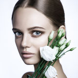 Calm Beauty Fashion Model Woman face. Portrait with white Rose flower. royalty free stock images