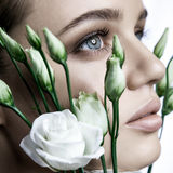 Calm Beauty Fashion Model Woman face. Portrait with white Rose flower. Stock Photography