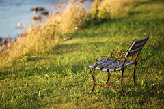 Calm bench at coast side Stock Photography
