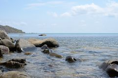 The calm Black sea with the large stones at noon Royalty Free Stock Photography