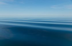 Calm blue Arctic Ocean with faint ripples Royalty Free Stock Photos