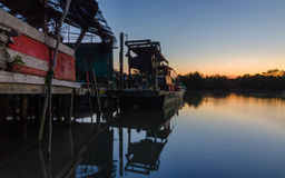 Calm blue hour sunset at fisherman village and wooden boat with Royalty Free Stock Photo