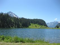 Calm blue lake in the mountains in summer. Calm blue lake in the mountains, in summer stock photo