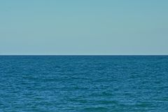 Calm blue mediterranean sea with blue sky. Minimalist background of a calm blue mediterranean sea with blue sky Royalty Free Stock Photos