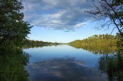 Free Calm Blue Northern Minnesota Lake And Treeline On A Sunny Evening Royalty Free Stock Image - 204594286