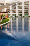 Calm Blue Pool at Tropical Resort Royalty Free Stock Photo