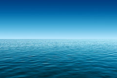 Calm blue sea and blue sky background Royalty Free Stock Images