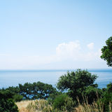 Calm blue sea and clear sky. Spring sunny day. Royalty Free Stock Photo