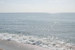 Calm blue sea. With small waves and blue sky Royalty Free Stock Image