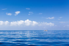 Calm blue seas and blue skies Stock Photos