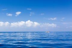 Calm blue seas and blue skies Stock Photos