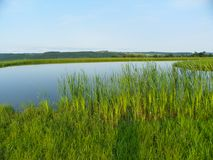 Peaceful pond overlooks distant valley and hills in NYS Stock Photography