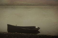 Calm boat. Vintage landscape with boat and calm lake in fogy morning Royalty Free Stock Photos