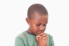 Calm boy praying. Against a white background Stock Images