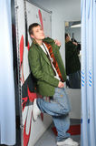 Calm boy stay in fitting-room Stock Photo