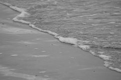 Calm breaking waves on the shoreline Stock Photo