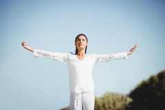 Calm brunette doing yoga Royalty Free Stock Images
