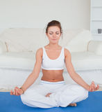 Calm brunette practicing yoga Royalty Free Stock Images
