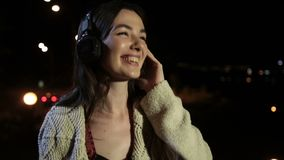 Calm brunette woman enjoying music in headphones stock video