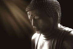 Calm buddha with light of wisdom. Peacful asian buddha zen tao religion art style statue stock photography