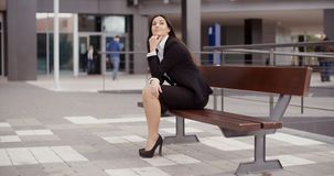 Calm business woman sitting outdoors Royalty Free Stock Photo