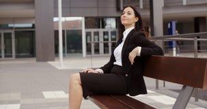 Calm business woman sitting outdoors Stock Photos