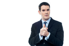 Calm businessman with clasped hands Stock Images