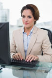 Calm businesswoman looking at computer Stock Photography